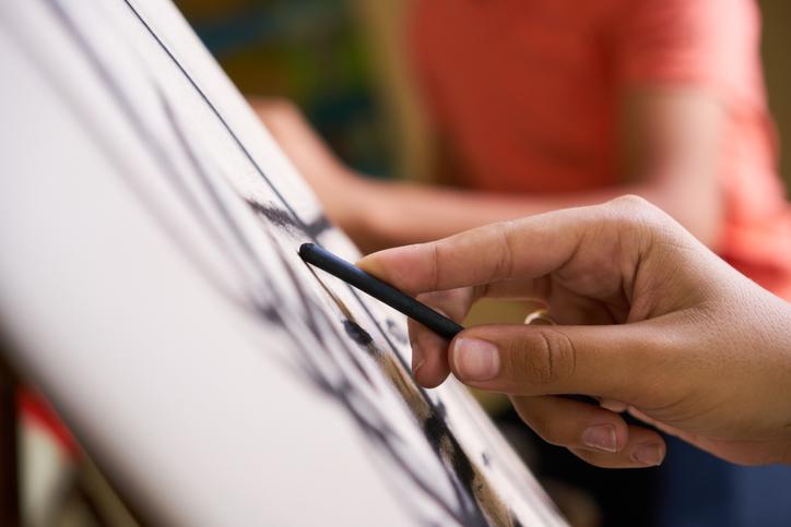 Closeup of someone sketching