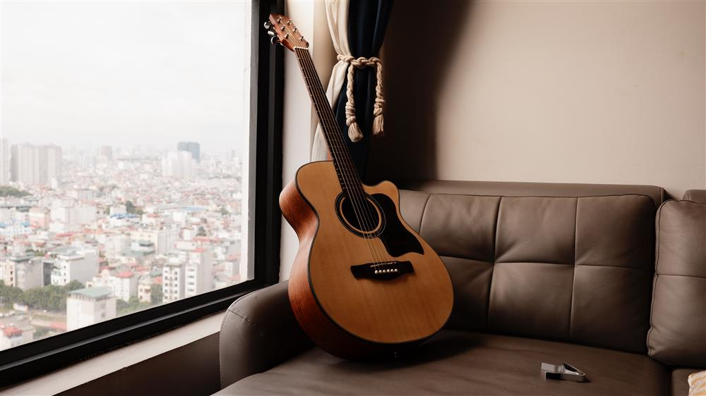 guitar on sofa